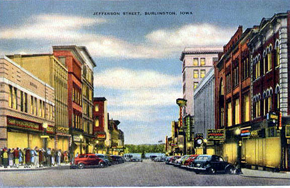 Postcard of Jefferson St., Burlington, Iowa, showing the Riepe-Peterson clothing store